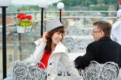 Happy young couple sitting at a table in a cafe Royalty Free Stock Photography