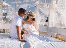 Happy young couple  sitting under a beautiful white baldachin Royalty Free Stock Image