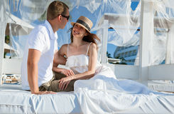 Happy young couple  sitting under a beautiful white baldachin Stock Image