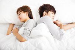 Happy young  couple sleep in  bed Stock Photography