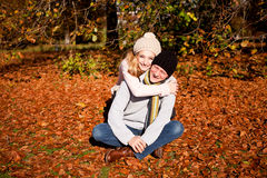 Happy young couple smilin in autumn outdoor Royalty Free Stock Photo