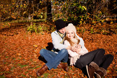 Happy young couple smilin in autumn outdoor Royalty Free Stock Photos