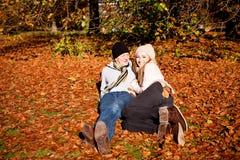 Happy young couple smilin in autumn outdoor Stock Photos