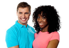 Happy young couple smiling. In front of camera Royalty Free Stock Photo