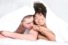 Happy young couple smiling. Stock Photo
