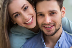 Happy young couple smiling stock images