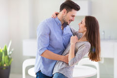 Happy young couple. Smiling and embracing royalty free stock photography