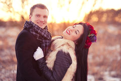 Happy young couple smiling and hugging. Cheerfull young lovers are smiling and hugging in sunlight Stock Photo