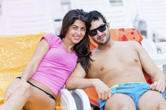 Happy young couple smiling , hugging and relaxing on the pool Stock Photo