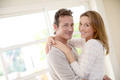 Happy young couple smiling indoors at home Stock Image