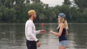 Happy young couple smiling laughing, slow motion. stock footage