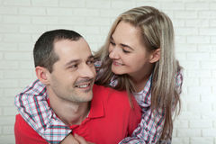 Happy young couple smiling. Man and woman hugging at home. Royalty Free Stock Photos
