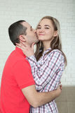 Happy young couple smiling. Man and woman hugging. Unusual top v Stock Photos
