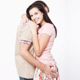 Happy young couple smiling. Man and woman hugging. Unusual top view isolated on white background Stock Image