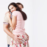 Happy young couple smiling. Man and woman hugging. Unusual top view isolated on white background Stock Photo