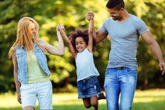 Happy young couple spending time with their daughter Royalty Free Stock Photography