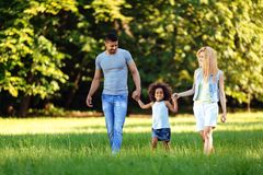 Happy young couple spending time with their daughter Royalty Free Stock Photo