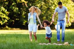 Happy young couple spending time with their daughter Stock Photography