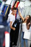 Happy young couple in sportswear  store Stock Photos