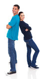 Couple back to back. Happy young couple standing back to back on white background Royalty Free Stock Image