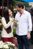 Happy young couple standing by flower shop Stock Photography