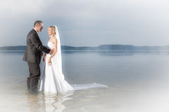 Happy young couple standing in a lake Royalty Free Stock Photos