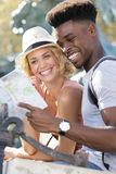 Happy young couple standing with plan royalty free stock images