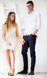 Happy young couple standing together Royalty Free Stock Image