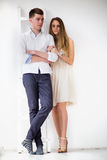 Happy young couple standing together Royalty Free Stock Images