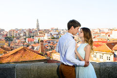 Happy young couple stands on background Porto Royalty Free Stock Image