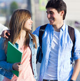 Happy young couple in the street after class Stock Photos