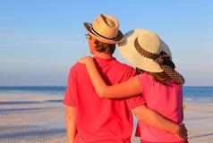 Happy young couple on summer beach Stock Photos