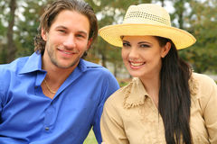 Happy Young Couple In Summer Day. Portrait of two young people outdoor summer day stock photos