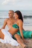 Happy young couple sunbathing Royalty Free Stock Image