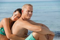 Happy young couple sunbathing Stock Photo