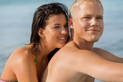 Happy young couple sunbathing Stock Images
