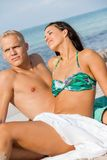 Happy young couple sunbathing Royalty Free Stock Photo