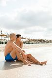 Happy young couple sunbathing Royalty Free Stock Photography