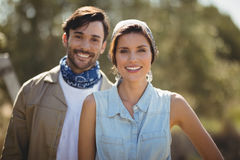 Happy young couple on sunny day at olive farm. Portrait of happy young couple on sunny day at olive farm Royalty Free Stock Photos