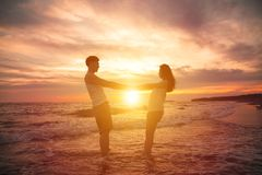 Happy young couple  at sunset Stock Photography