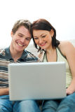 Happy young couple surfing internet Stock Photo