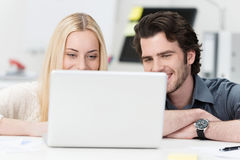 Happy young couple surfing the internet Royalty Free Stock Photography