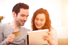 Happy young couple surfing on a tablet Stock Image