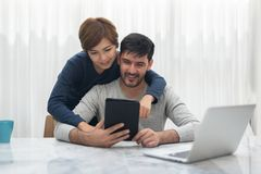 Happy Young couple with tablet royalty free stock photo