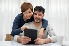 Happy Young couple with tablet. royalty free stock photo