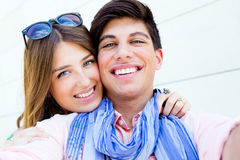 Happy young couple taking photos with a smar Royalty Free Stock Image