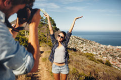 Happy young couple taking pictures while hiking Royalty Free Stock Photo