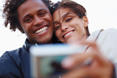 Happy young couple taking a portrait Stock Image