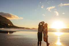 Happy young couple taking self portrait at beach Stock Photos