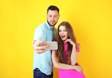 Happy young couple taking selfie Royalty Free Stock Photography